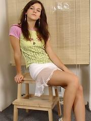 Shy teen slowly strips to panties