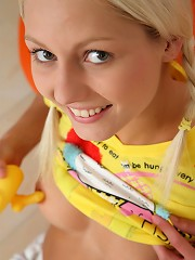 Blond and blue-eyed teen Pinky June masturbating with duck