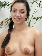 A horny latina masturbates alone